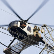 Stock Photo: Helicopter High Lines Construction