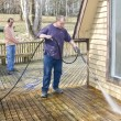 Pressure washing deck — Stock Photo