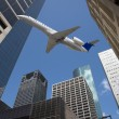 Downtown Buildings & Jet Air Plane — Stock Photo