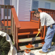 Painter Painting Deck - Stock Photo