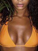 Photo of girl breasts in orange bikini — Stockfoto