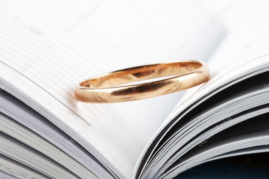 Wedding ring putted on the opened book  Stock Photo #7620359