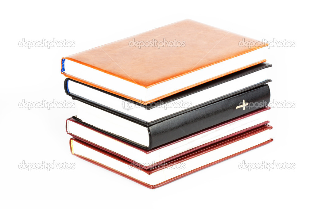 Holy Bible between books on the white background  Stock Photo #7808195