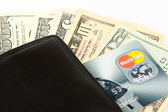 Money and credit card in a wallet — Stock Photo