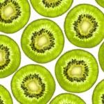 Fresh juicy kiwi slices background — Stock Photo