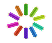 Multicolor sewing threads on white background — Stock Photo