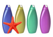 Colorful shampoo bottles and red sea-star isolated on white — Stock Photo