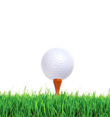 Golf ball on green grass over white background — Stock Photo