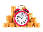 Red alarm clock with golden coins over white background — Stock Photo