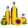 Beautiful sunflower and glass bottle of oil isolated on white — Stock Photo