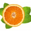 Fresh orange slice and leaves of mint isolated on white — Stock Photo