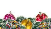 Colorful christmas balls among green new year tree on white back — Stock Photo