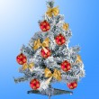 Decorated christmas tree over blue background — Stock fotografie