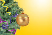 Christmas concept with baubles and new year tree over yellow — Stockfoto
