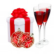 Stock Photo: Beautiful gift in white packaging, two wineglass and red christm