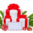Foto Stock: Christmas Gift Boxes, Decoration Balls and Tree Branch isolated