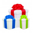 Stock Photo: Beautiful gift boxes with colorful bows isolated on white