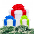 Beautiful gift boxes with colorful bows and christmas tree fir i — Stock Photo