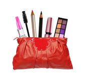 Beautiful red makeup bag and cosmetics isolated on white — Stock Photo
