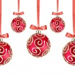 Red Christmas balls with bows on white background — ストック写真