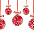 Red Christmas balls with bows on white background — Stock Photo