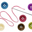 Bright sewing buttons and needle with thread isolated on white — Stock Photo
