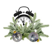 Green Christmas tree, decoration balls and alarm clock isolated — Stock Photo