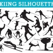 Skiing silhouettes - Stock Vector