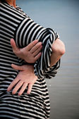 Hands on the striped — Stock Photo