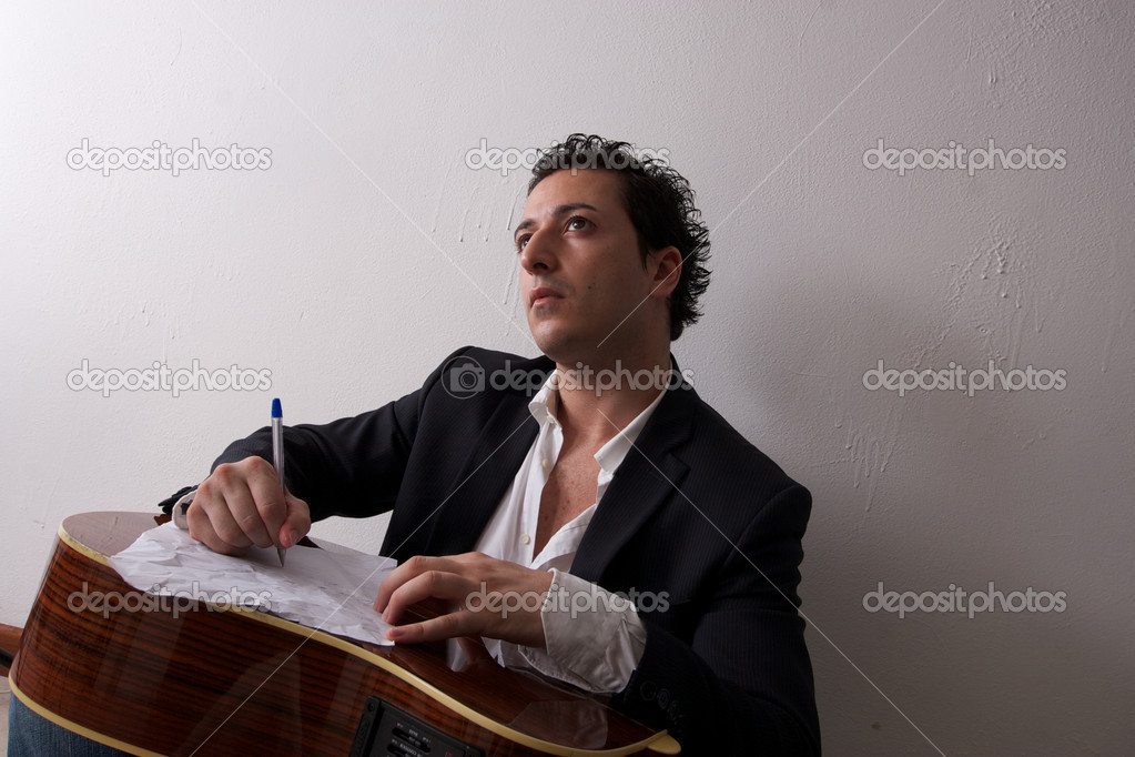 Singer songwriter with his guitar — Stock Photo #6823672