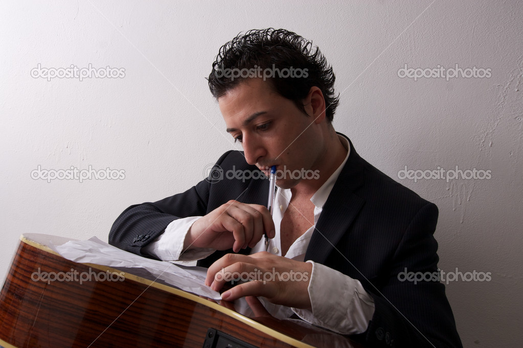 Singer songwriter with his guitar  Stock Photo #6823675