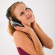 Happy attractive girl in headphones listens to music — Stock Photo #6751597