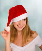 Beautiful happy girl in a Christmas hat — Stock Photo
