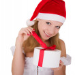 Cheerful young girl with Christmas present — Stock Photo