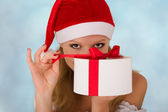 Attractive girl with Christmas present — Stock Photo