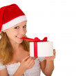 Stock Photo: Cheerful young girl with Christmas present