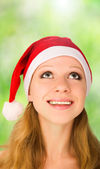 Christmas woman looking up — Stock Photo