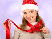 Christmas girl with red bow — Stock Photo