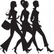 Silhouette of three shopping girls - Stock Vector