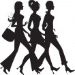 Stock Vector: Silhouette of three shopping girls