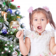 Beautiful girl with a Christmas tree — Stock Photo