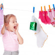 Beautiful girl hangs socks — Stock Photo