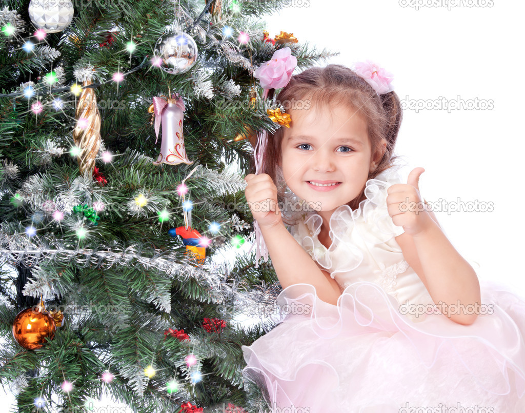 Beautiful girl with a Christmas tree — Stock Photo #7533200