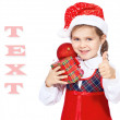 Beautiful girl in the hat of Santa Claus — Stock Photo #7949039