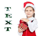Beautiful girl in the hat of Santa Claus — Stock Photo