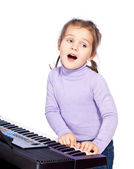 Girl playing the piano — Stock Photo