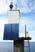 A small lighthouse with the solar battery. — Stock Photo