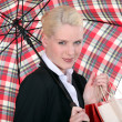 Portrait of a young woman with umbrella — Stock Photo #6985137