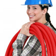A woman carrying pipes. — Stock Photo