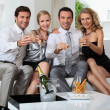 Royalty-Free Stock Photo: Two couples drinking champagne at home